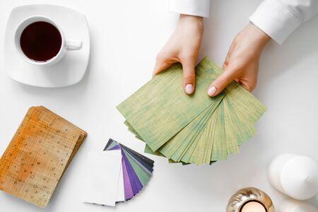 Woman hold metaphorical associative cards.