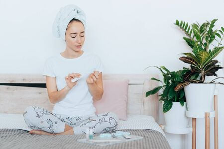 Girl makes a manicure at home. Stock Photo