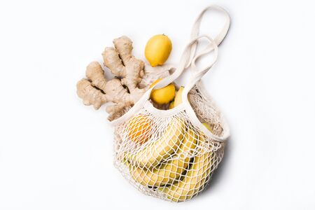 Reusable shopping bag with organic fruits and vegetables.