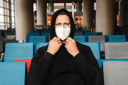 Men with respirator mask in airport.