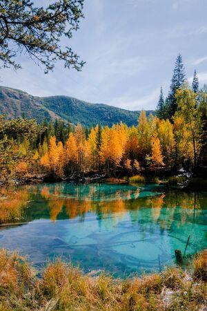 Blue geyser lake Golden autumn in Altai.