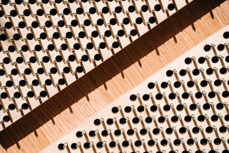 Wooden board with nails for practicing yoga. Concept of healthy stimulation of blood flow in the legs.