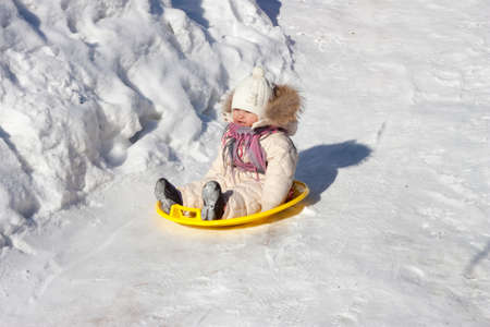a child riding a roller coaster in the winter on the tablet