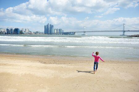 The girl runs on the beach Stock Photo