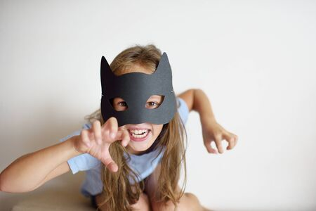 decorate: The girl plays in a self-made mask of black cat