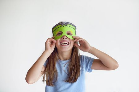 decorate: The girl plays in a self-made mask of Frankenstein