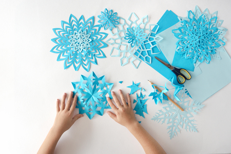 Making of snowflakes from paper