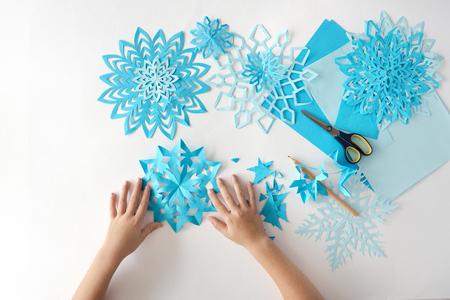Sneeuwvlokken maken van papier