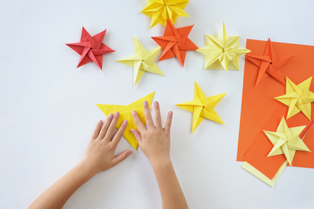 Lesson of origami. A Christmas star from paper