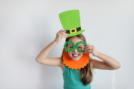 The lovely girl in a mask of a leprechaun for a St. Patricks Day
