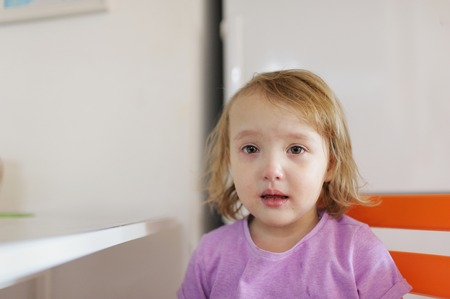 The little girl cries. Tear-stained face at the girl