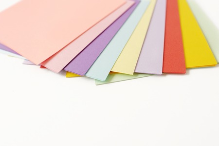 Color paper on a white background for a lesson of origami Stock Photo