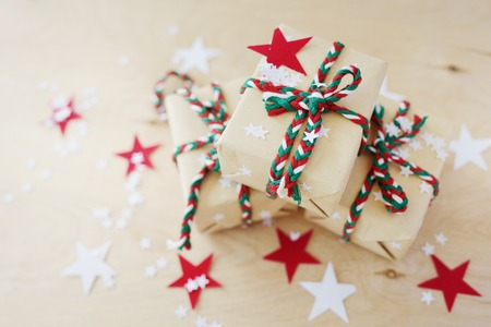 Christmas gifts packing on a wooden background
