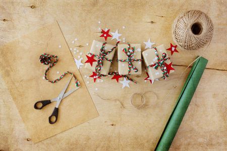 Christmas gifts in Kraft to packing on a wooden background