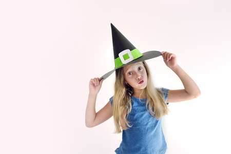 The girl plays in a self-made mask of witch for Halloween 版權商用圖片