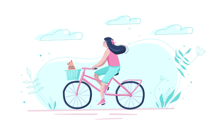 The cute girl goes by bicycle with a dog in a basket down the street.