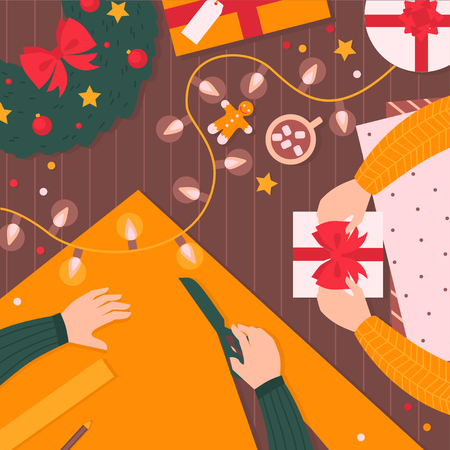 Wrapping Christmas gifts. Top view of decorative paper, present boxes and ribbons on a table with hands. Wreath, garland, gingerbread, tea cup and confetti. Cartoon Workshop. Winter holiday card