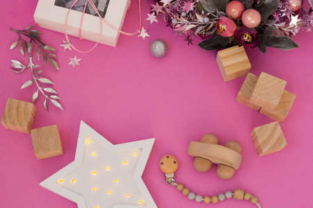Christmas Present for Kids top view. Ecological Baby toys flatly. Holiday Banner with copy space. Wooden Blocks, car, wreath and festive decor