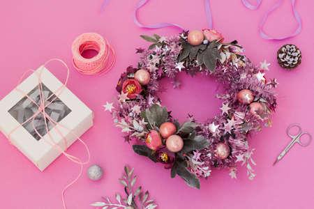 Handmade christmas wreath, new year decoration. DIY holiday decor. Florist festive workshop. Packaging design. Фото со стока