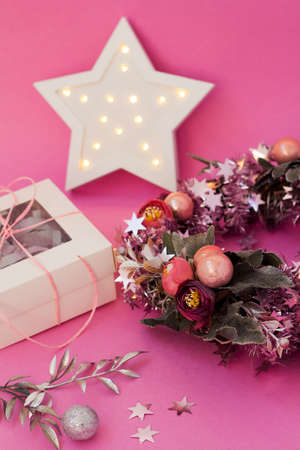 Girly christmas decoration. Floral wreath with baubles. Cute card with lights and gift box. Holiday decor for girl. Фото со стока