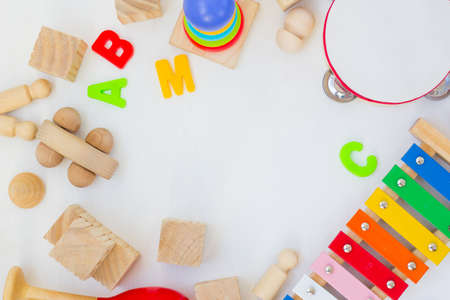 Ecological Wooden Vintage toys copy space. Retro musical instruments on white background. Kids banner. Eco games set