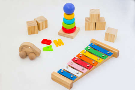 Kids banner on white background. Ecological Wooden set of toys pyramid, letters, Car, Blocks and xylophone