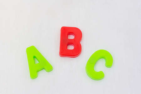Letters abc on white background. learning alphabet with plastic toy, english language school