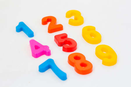 Kids plastic numeral on white background. Study counting with fridge magnets. Education in preschool and primary school