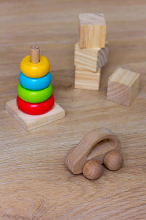 Ecological toys made from natural material. Wooden Car, Blocks and pyramid