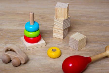 Kids toys made from natural material. Ecological Wooden Car, Blocks, pyramid and maraca