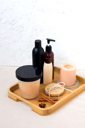 Beauty products for aromatherapy in Spa salon. Body treatment. Wellness concept. Oil, soap, cream, shampoo with spices Фото со стока