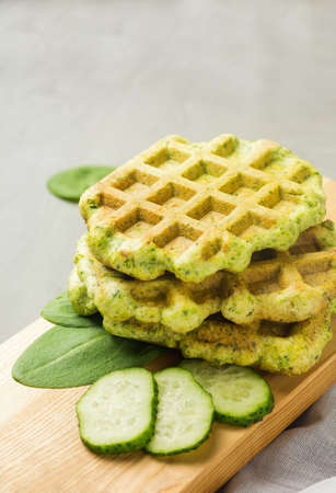 Spinach waffles on wooden board. Helthy vegetarian cuisine. Homemade food. Reklamní fotografie