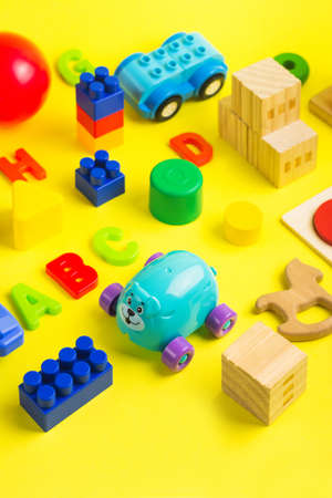 Plastic and wooden colorful toys blocks, car, letters and bricks. Activity for kids in day care and kindergarten. Reklamní fotografie