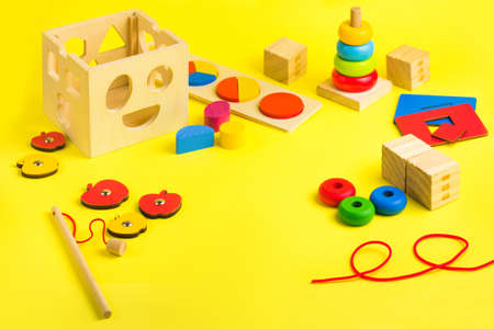 Ecologic Wooden colorful toys blocks, puzzle, magnetic fishing game and lacing. Activity for kids in day care and kindergarten Reklamní fotografie