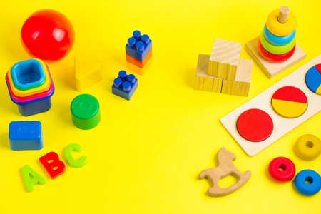 Plastic and wooden colorful toys blocks, letters and bricks. Activity for kids in day care and kindergarten.