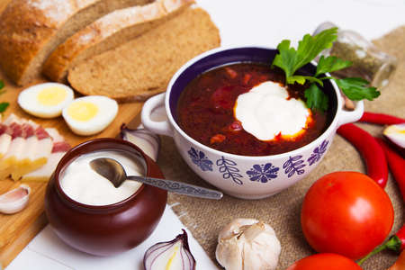 meaty: Traditional ukrainian meaty borscht on the table with ingredients