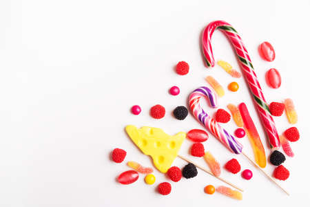 Colorful candies and jellies on the white background. Top view with copy space Stock Photo