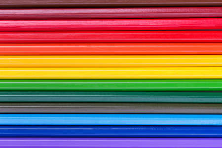Abstract background of rainbow colorful pencils. Top view
