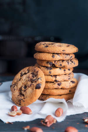 Homemade chocolate chip cookies and peanut on dark grunge background. Space for text Stock fotó