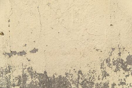 neutral color textureneutral color textured concrete wall that was painted but the paint faded or fell offd concrete wall Stockfoto