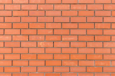 red bricks neatly stacked in a flat wall form a beautiful stylish background