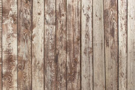 background of rough wooden boards in the form of a fence with peeling grunge paint