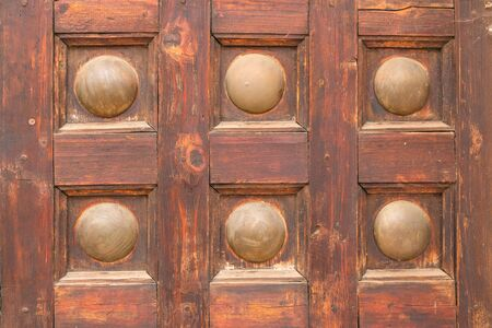 Fragment of a decor of an old wooden and metal door 写真素材