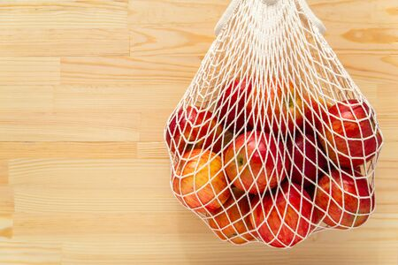 Red apples in a reusable bag mesh