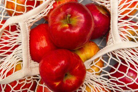 Red apples in a reusable white bag mesh Stock fotó