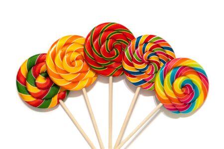 Round multi-colored bright lollipops on a wooden stick Zdjęcie Seryjne