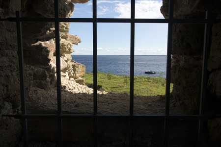 view of the sea from behind the lattice