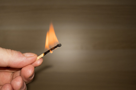 burned match in hand