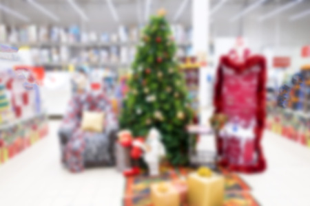 Abstract and de-emphasized background of the store on the eve of the New Year and a Christmas tree in the store. Stock fotó