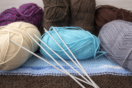 Knitting needles, multi-colored yarn set for the needlewoman.